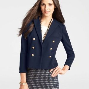 Navy blazer with gold buttons